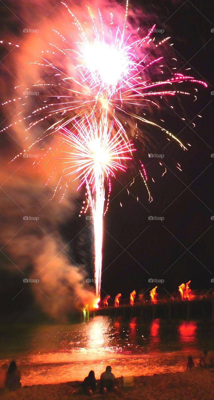 Firework at night at beach