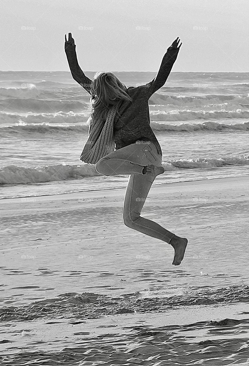 Foot loose and fancy free - like the wind. This young lady was thrilled to walk on the white sandy beach in front of the Gulf if Mexico