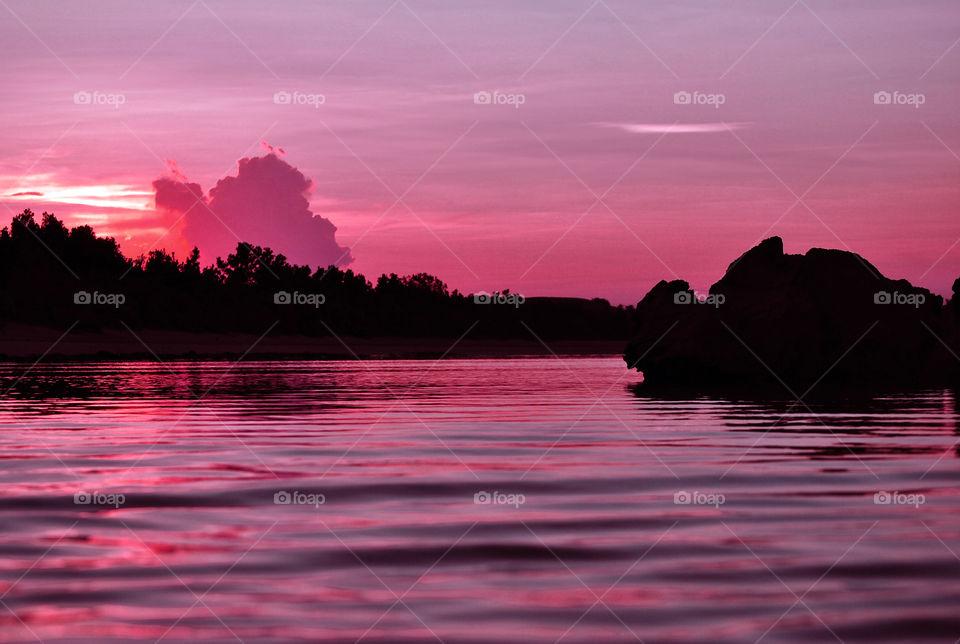 Pink sky reflection on lake
