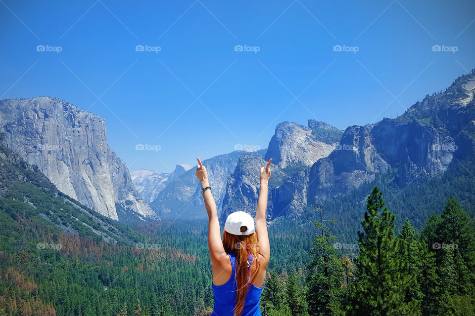 yosemite, national park, girl wearing cap, blue, back, doing number one sign, california, United States, America
