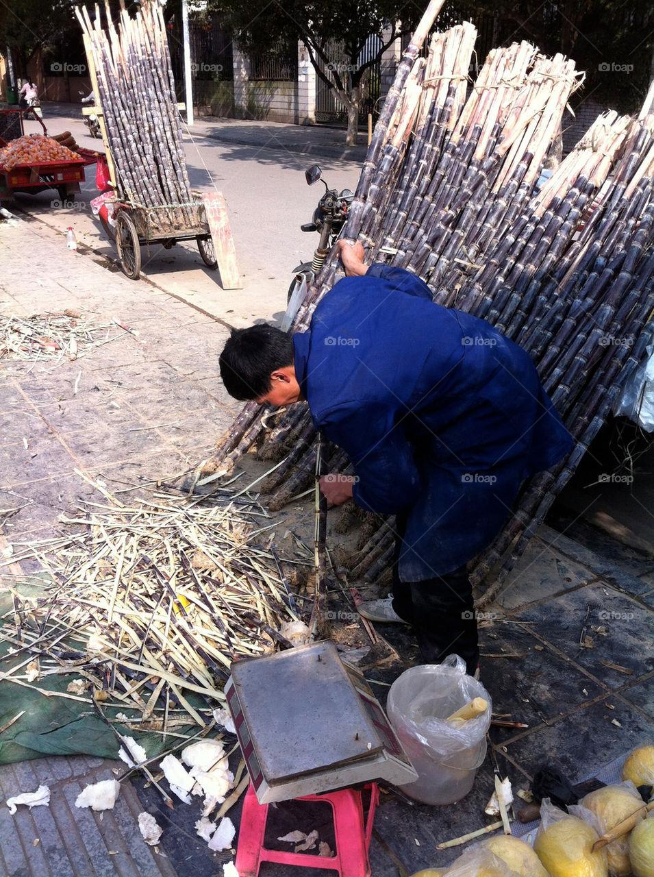 A sugarcane vendor on the streets og Guilin, China.