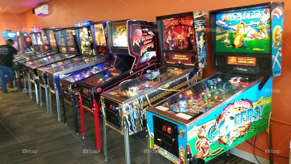 classic pinball arcade machines in a row