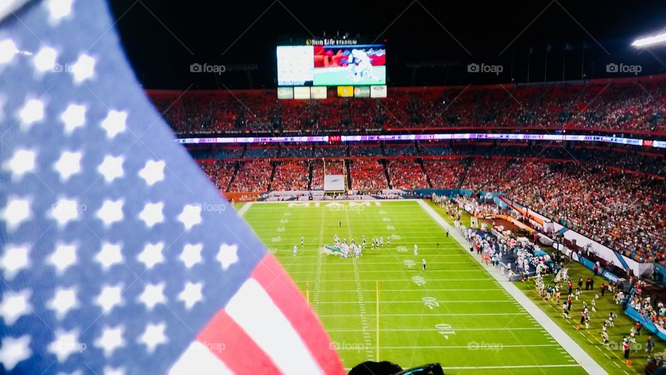 American football court on a game day with American flag