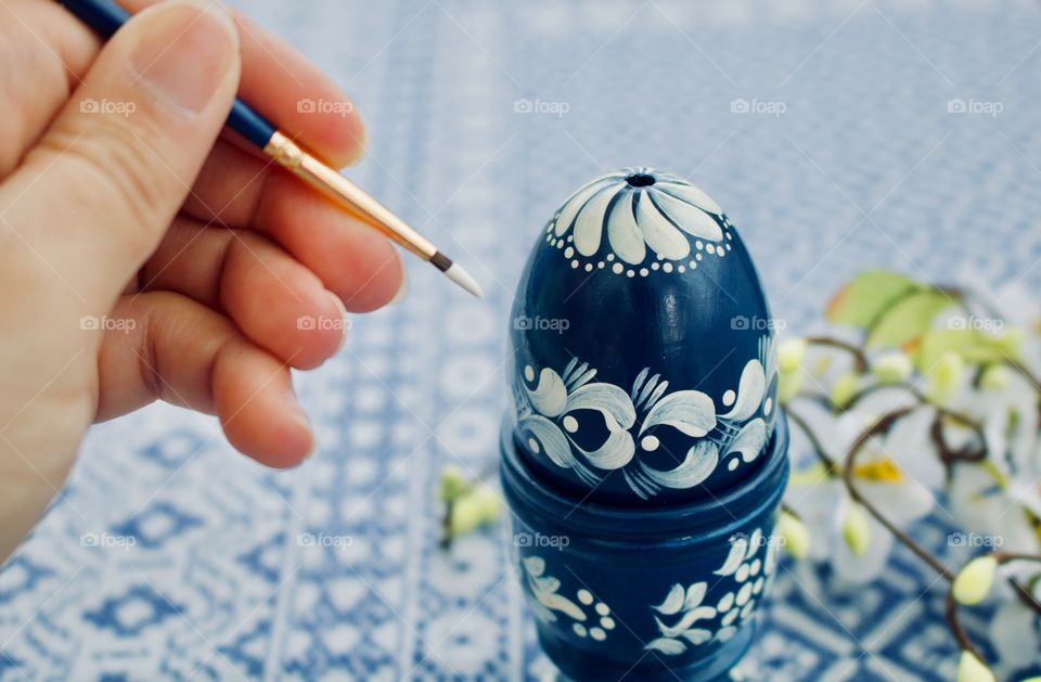 Painting an egg for Easter