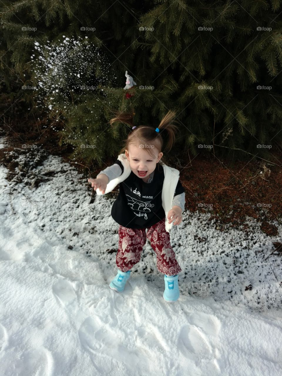 Cute girl playing with snow