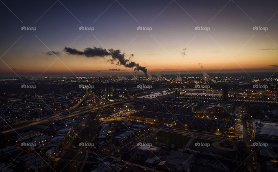Sunset over South Philadelphia, PA with the gas refinery pumping steam.