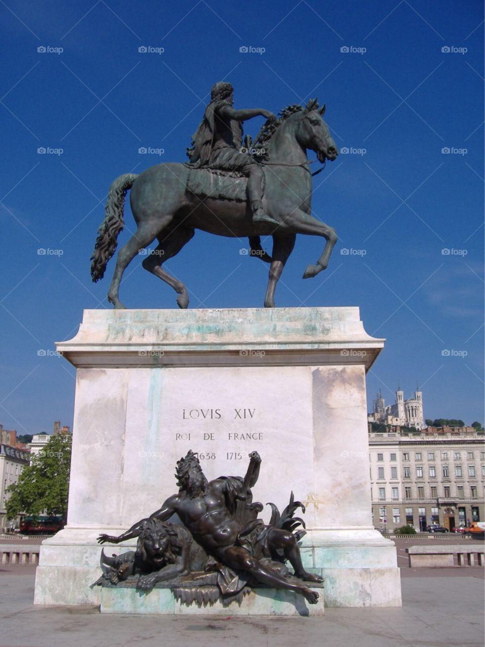 Statue of Louis XIV, Roi de France in a plaza. Lyon, France.