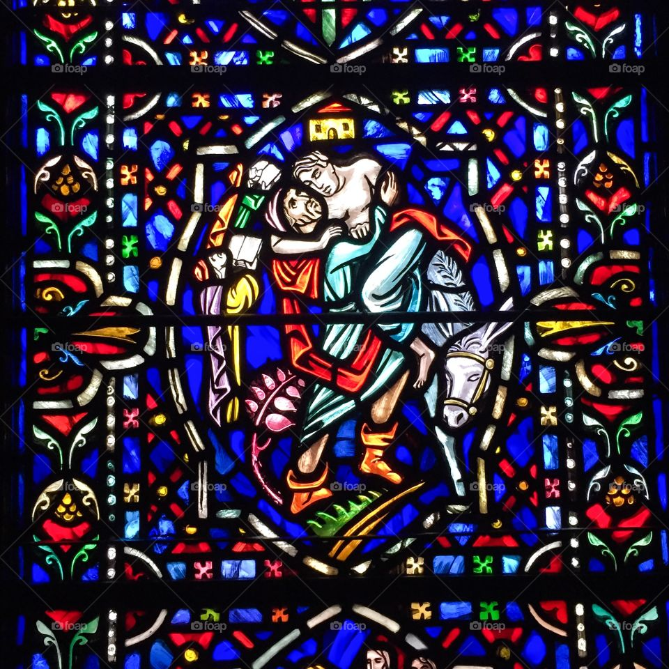 Parable of the Good Samaritan. Stained glass window at Westminster Presbyterian Church in Minneapolis, Minnesota