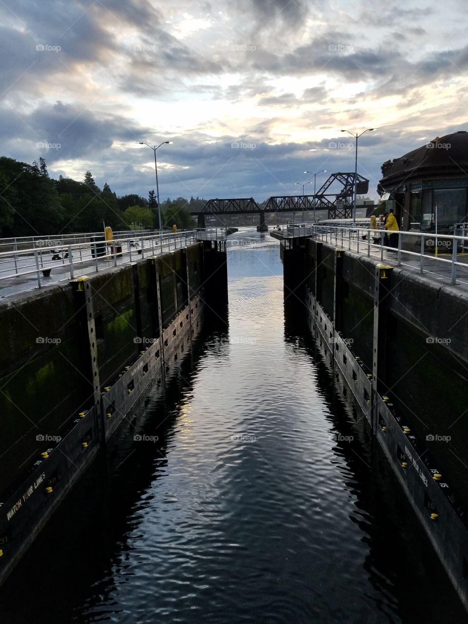 small chamber with gates on salt water side in motion. Hiram M Chittenden Locks. Seattle, Washington 5/19/2016