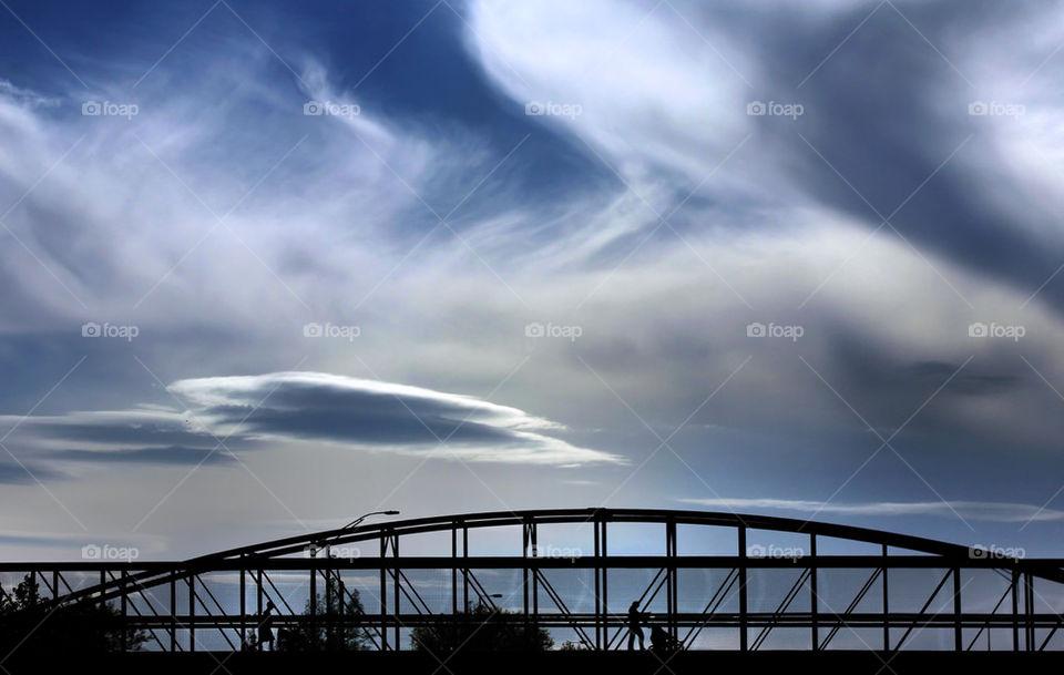sky clouds bridge silhouette by detrichpix