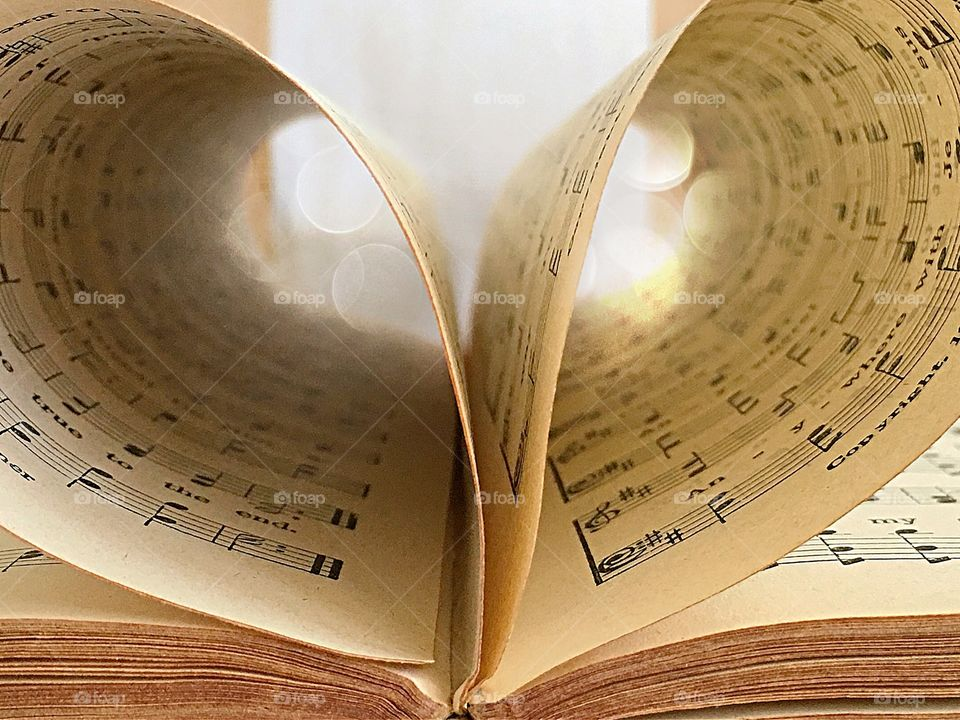 Old antique Christian hymnal book with heart shaped pages