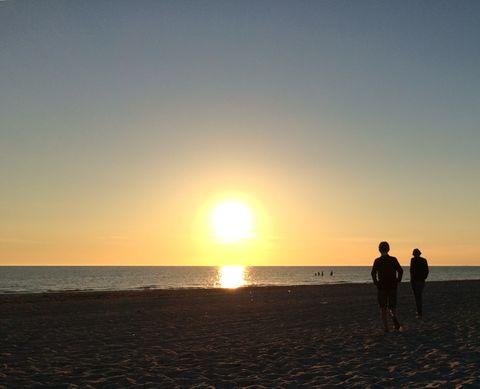 Summer sun set. Boys in summer sun set