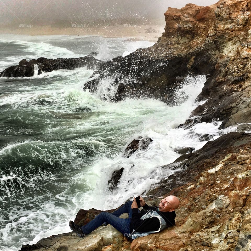 Joy in the midst of crashing waves! My husband in his element!