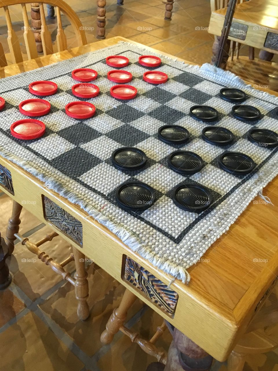 Maybe you'd be up for a game of checkers with these big pieces. Can't cheat very easily.