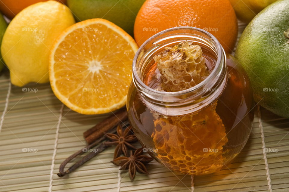 Close-up of honey with spices and citrus fruits