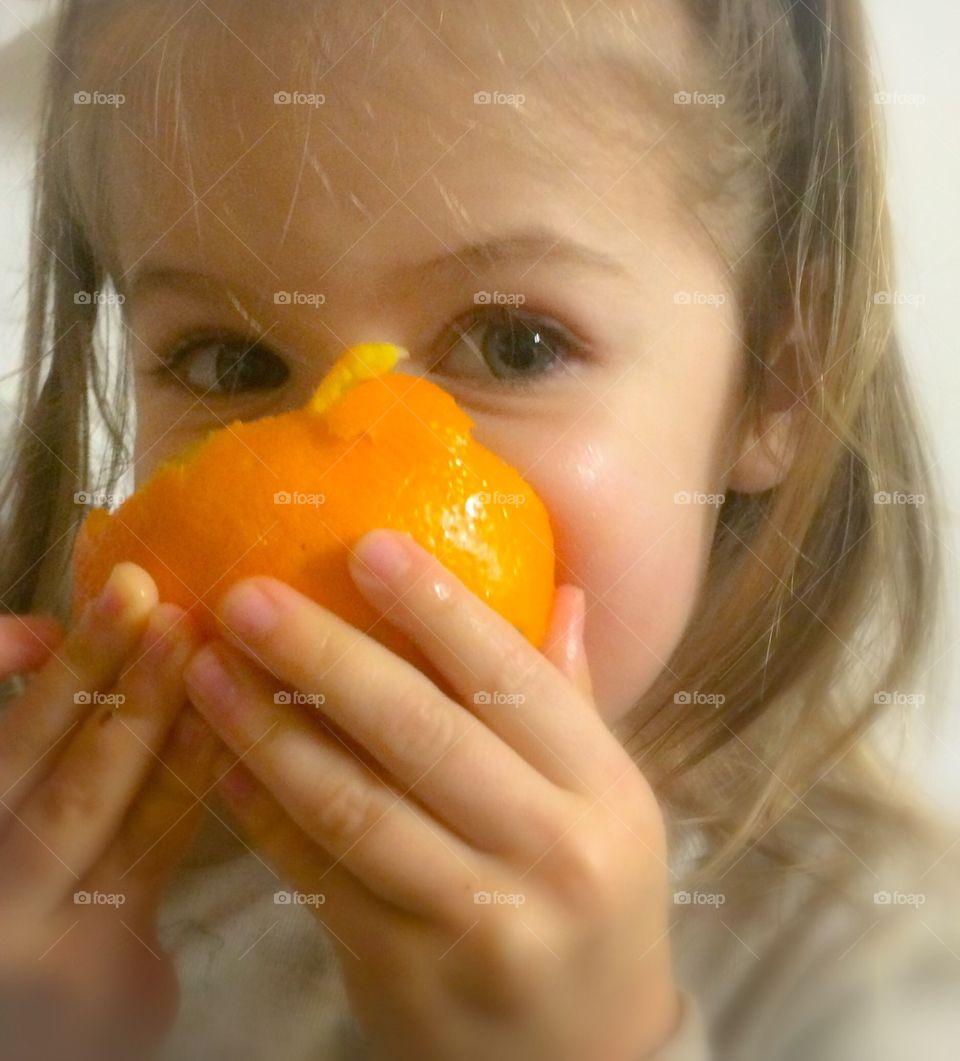 Girl Eating Orange