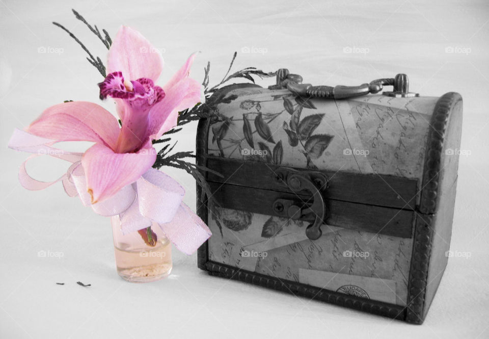 Orchid flower in glass vase with jewelry box