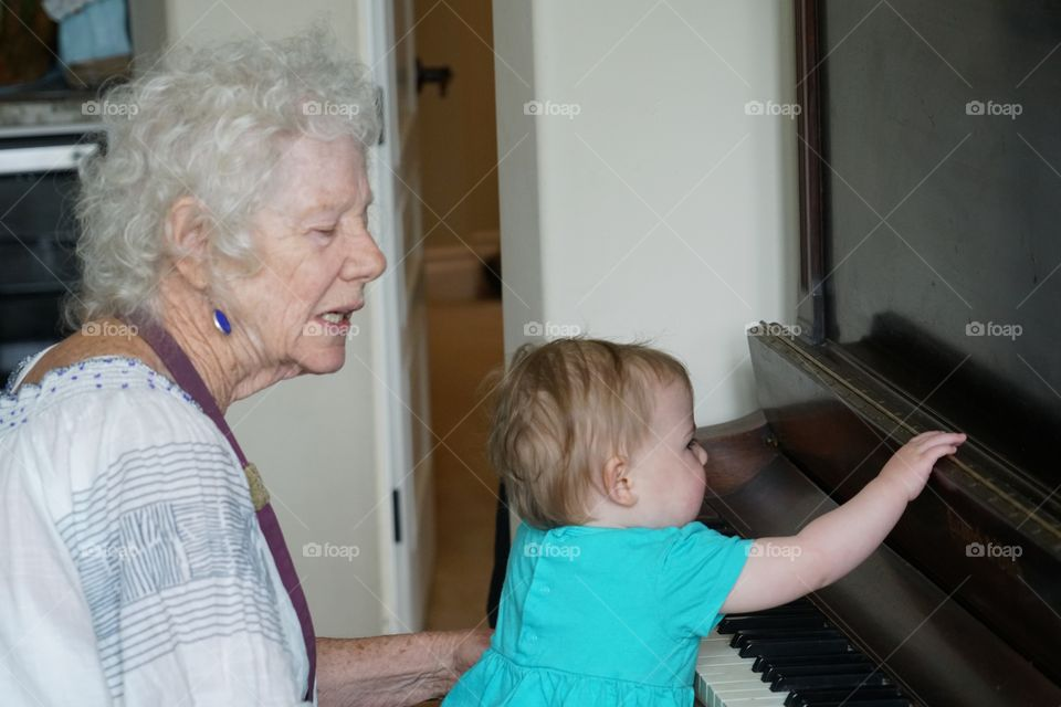 Grandmother And Baby Playing Piano