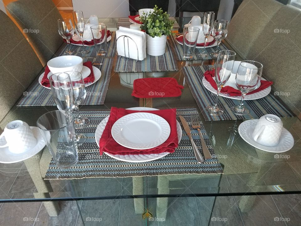 Place setting on glass dinning Table