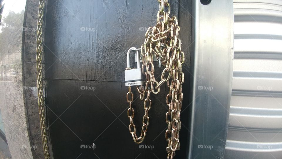 gold locks with silver lock on gate