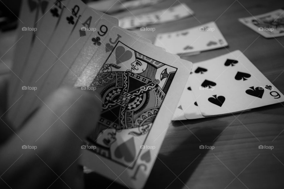Close-up of person's hand holding playing cards