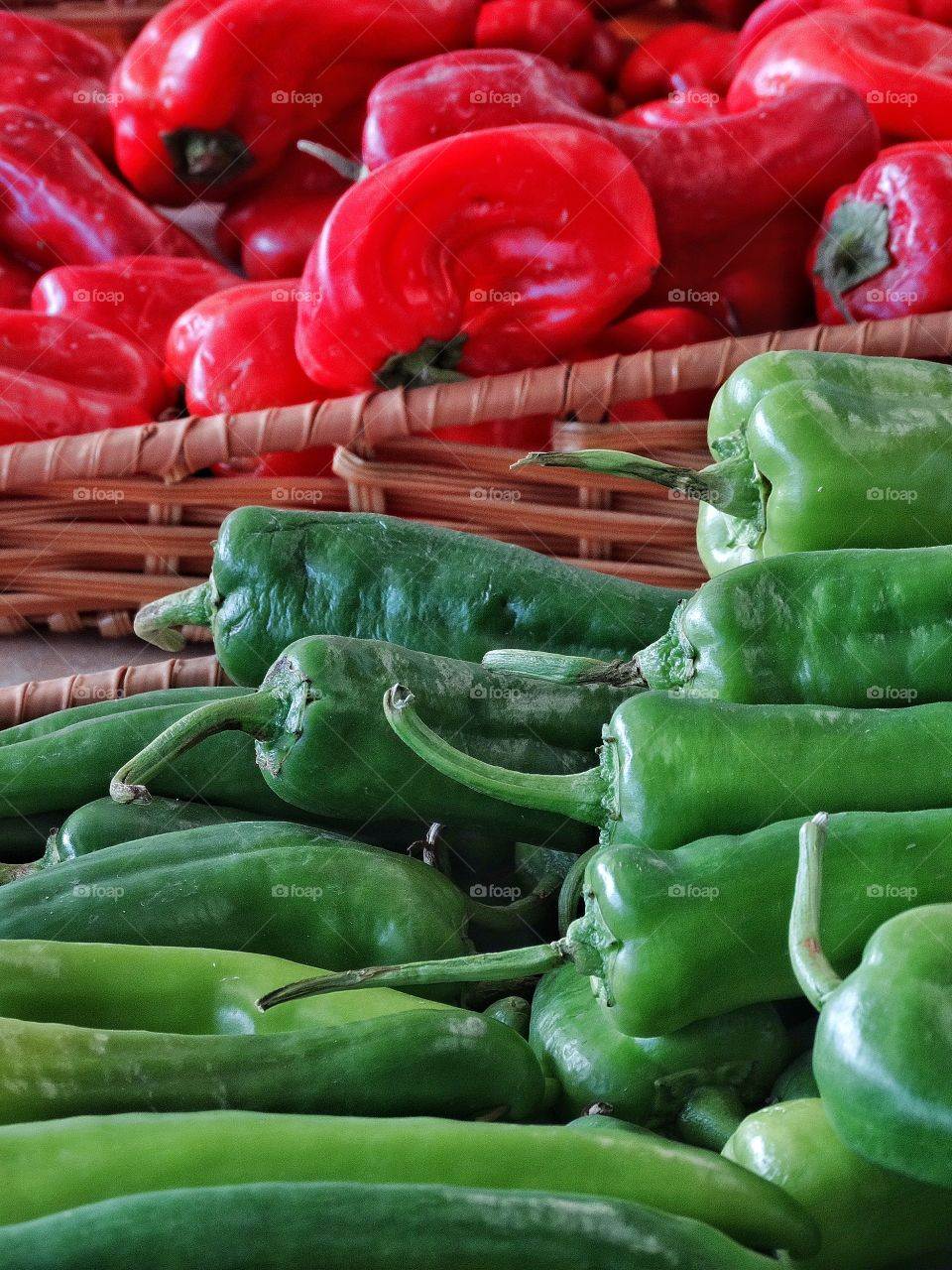 Fresh Red And Green Peppers. Fresh Organic Bell peppers On Display At A Farmer's Market