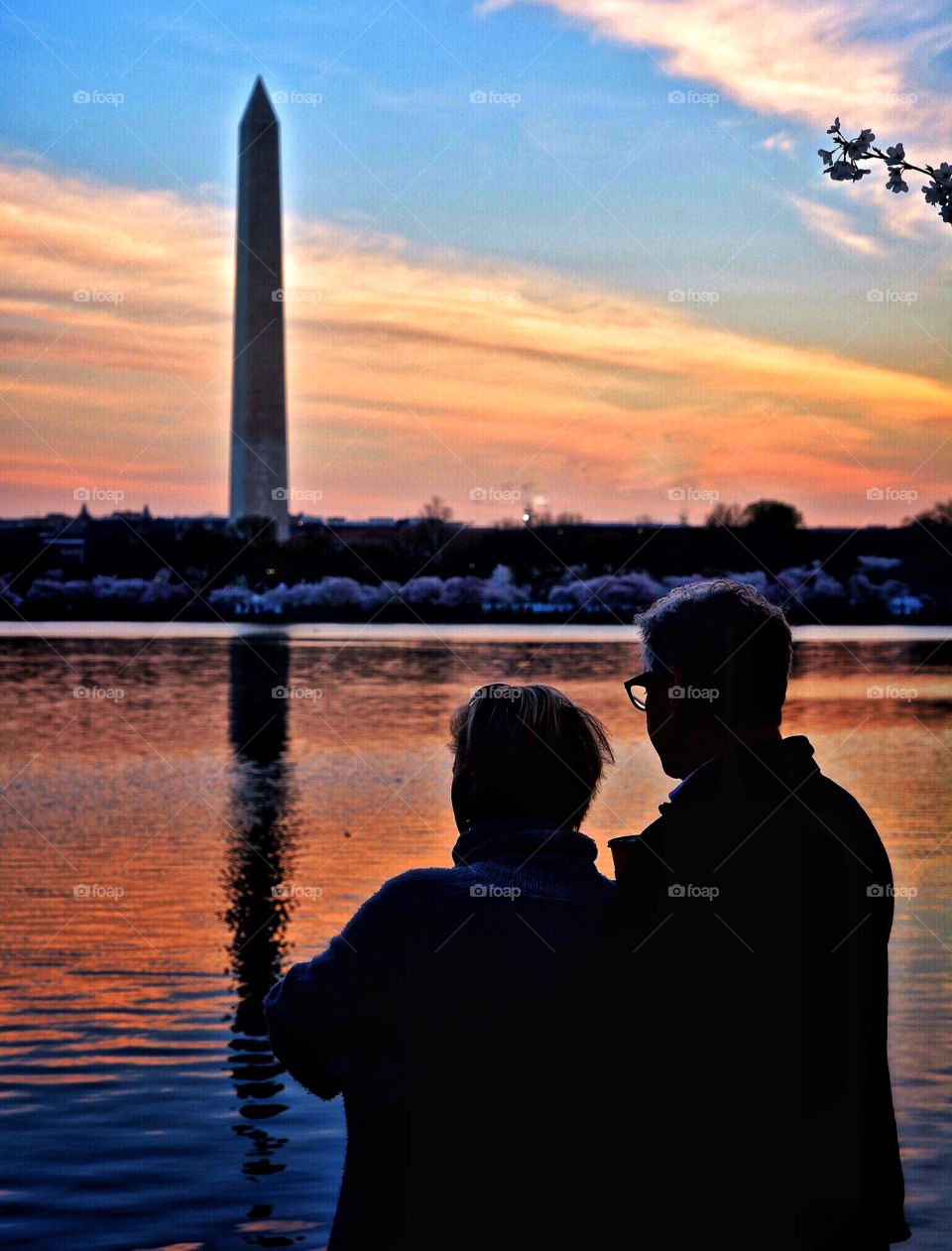 Baby boomer couple at the Washington Monument at sunset