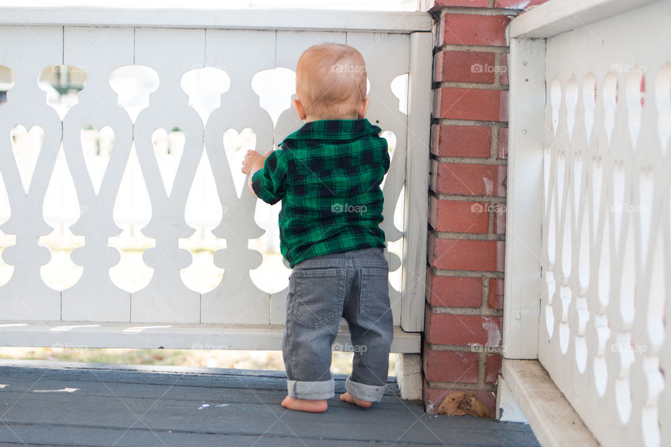Rear view of a standing baby boy