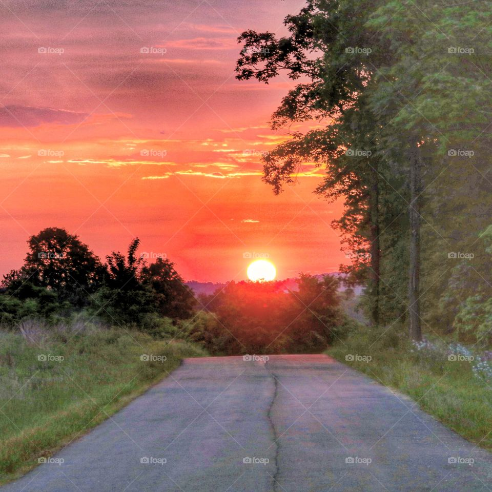 down a country road at sunrise