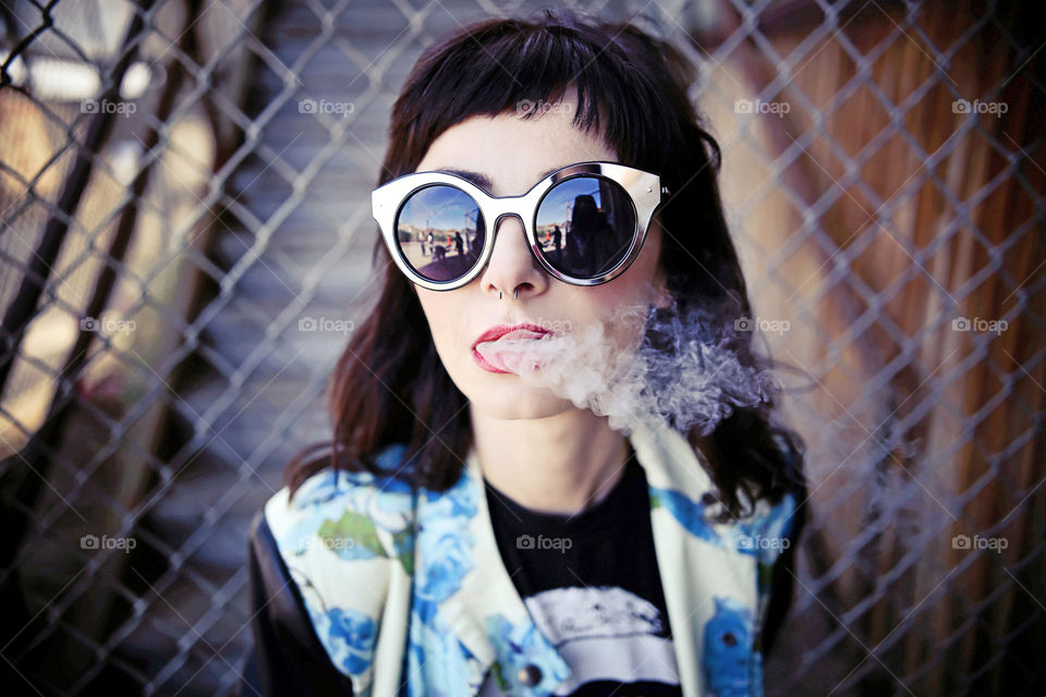 Close-up of a teenage girl smoking