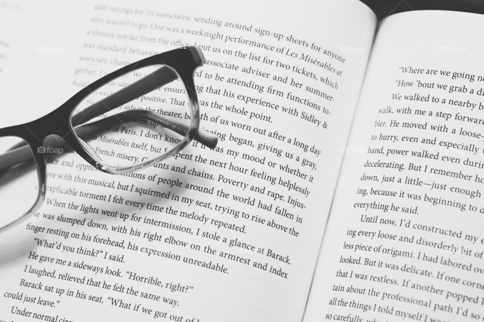 Reading As A Hobby, Reading A Book, Glasses With Book, Monochrome Image, Relaxing Hobby, Learning From Your Hobby, Text, Open Book, Open Book With Glasses, Becoming By Michelle Obama