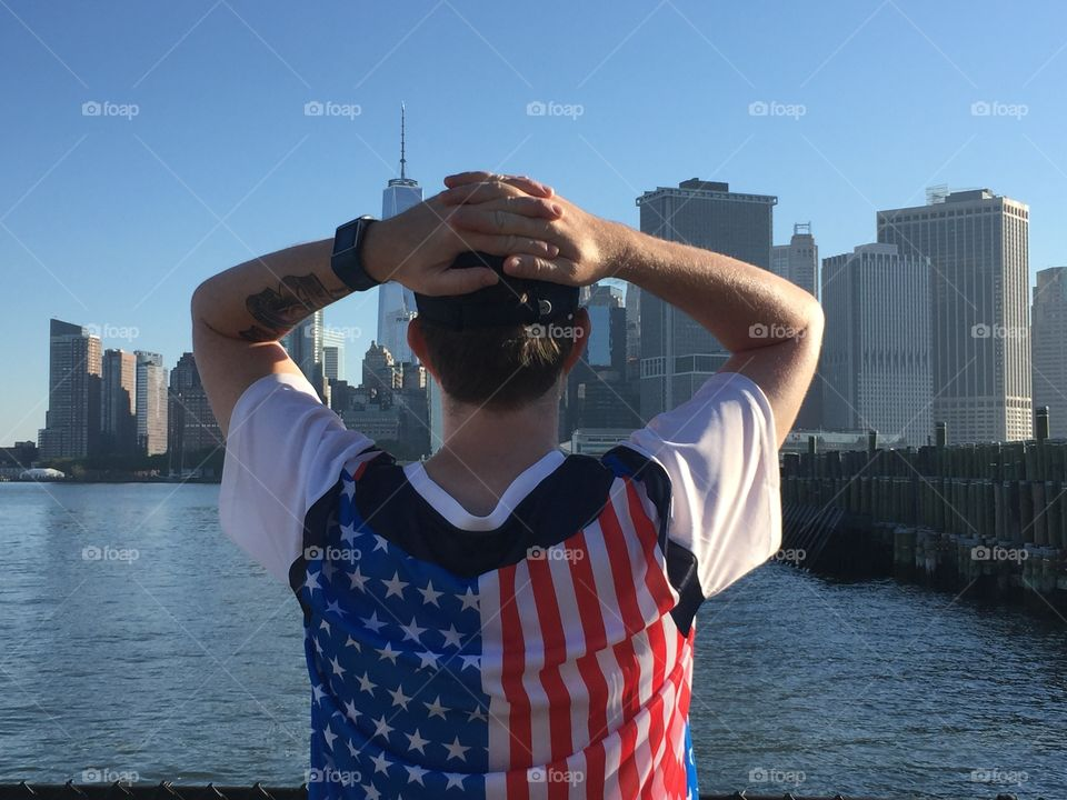 Man looks out on World Trade Center in patriotic attire