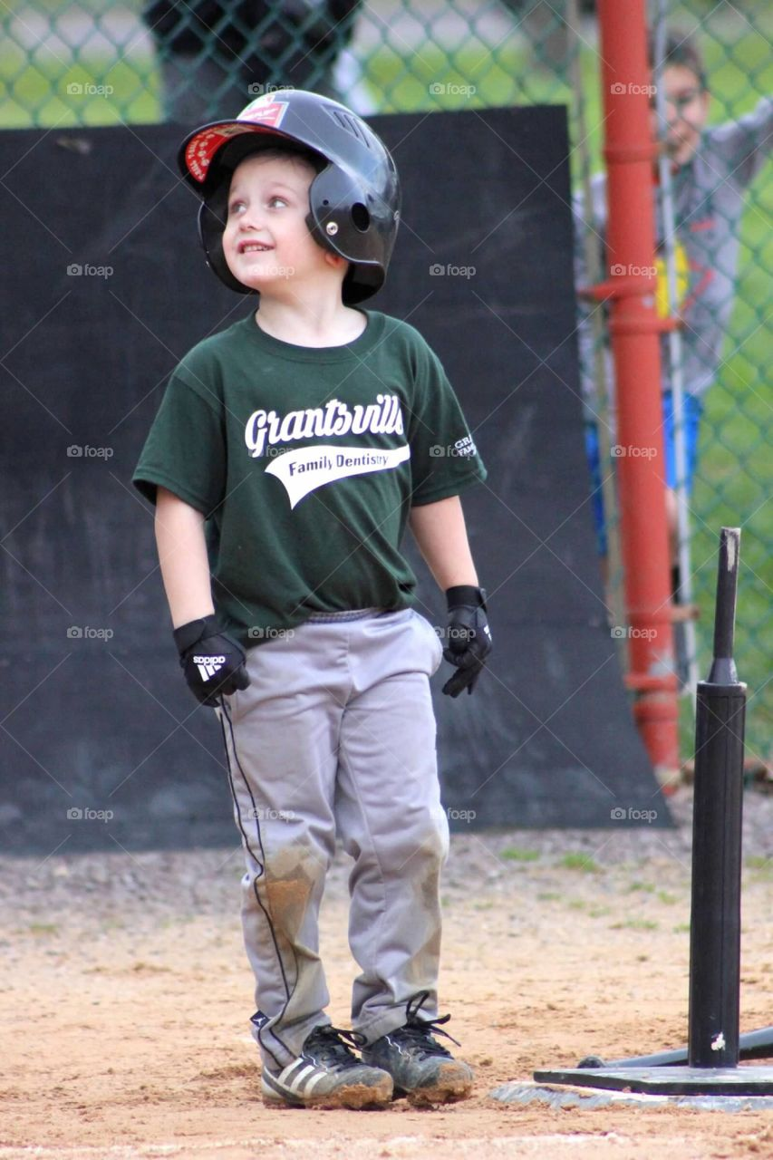 My little ball player scored his first run at his T-ball game, looking up proudly at his coach.