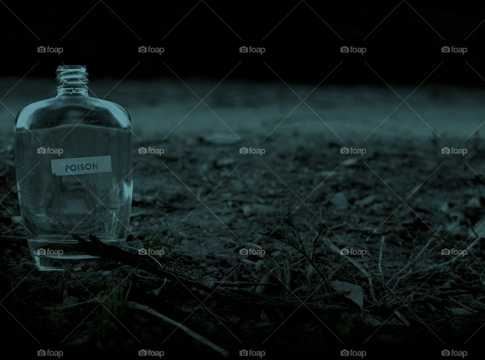 Poison bottle on barren land