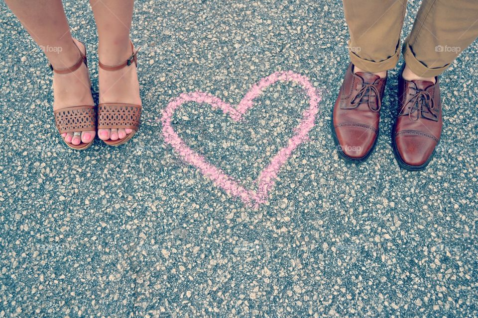 Love Will Take You Anywhere. Engagement photo showing off shoes.