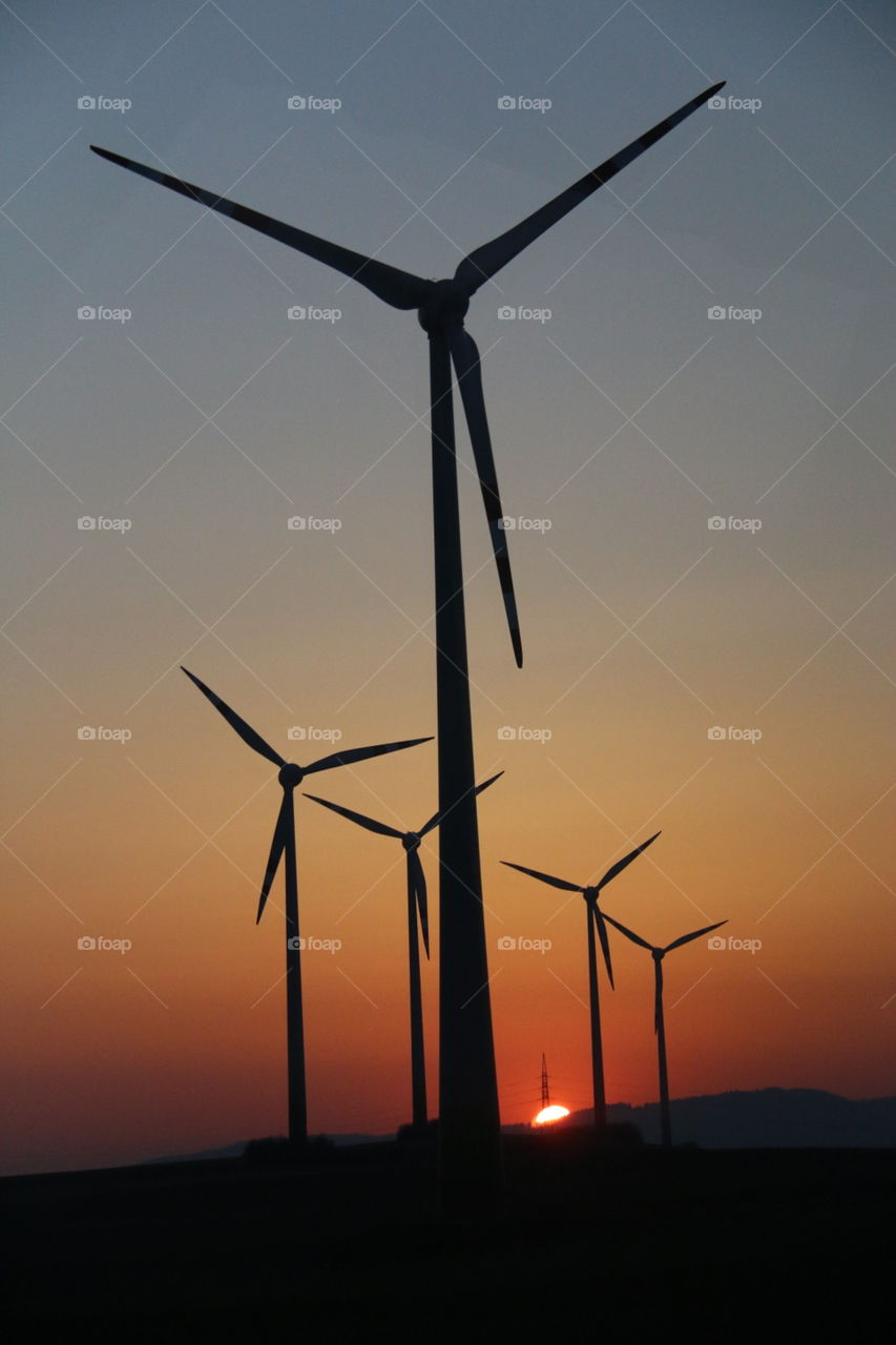 Aero Mill Energy. Aero Mills found at Eastern Europe during sunset time