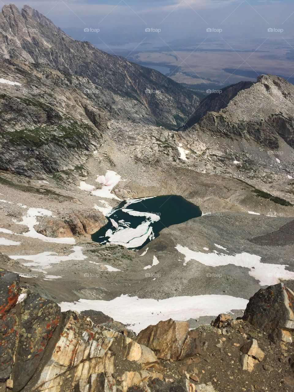 A hidden lake in the Grand Tetons, covered in glaciers