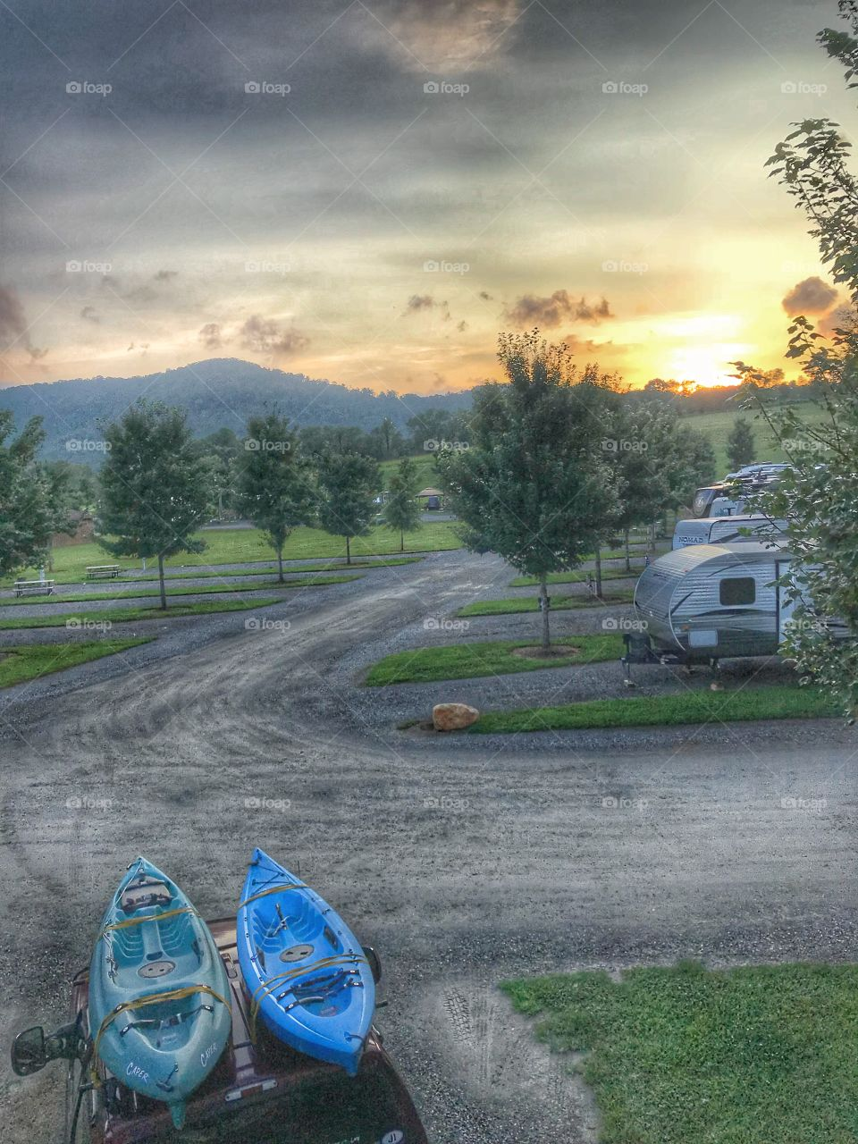 View from the top of our camper at sunset which includes the mountains and our kayaks