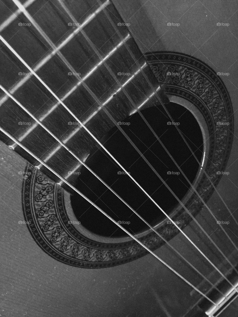 Macro Black and white of a guitar