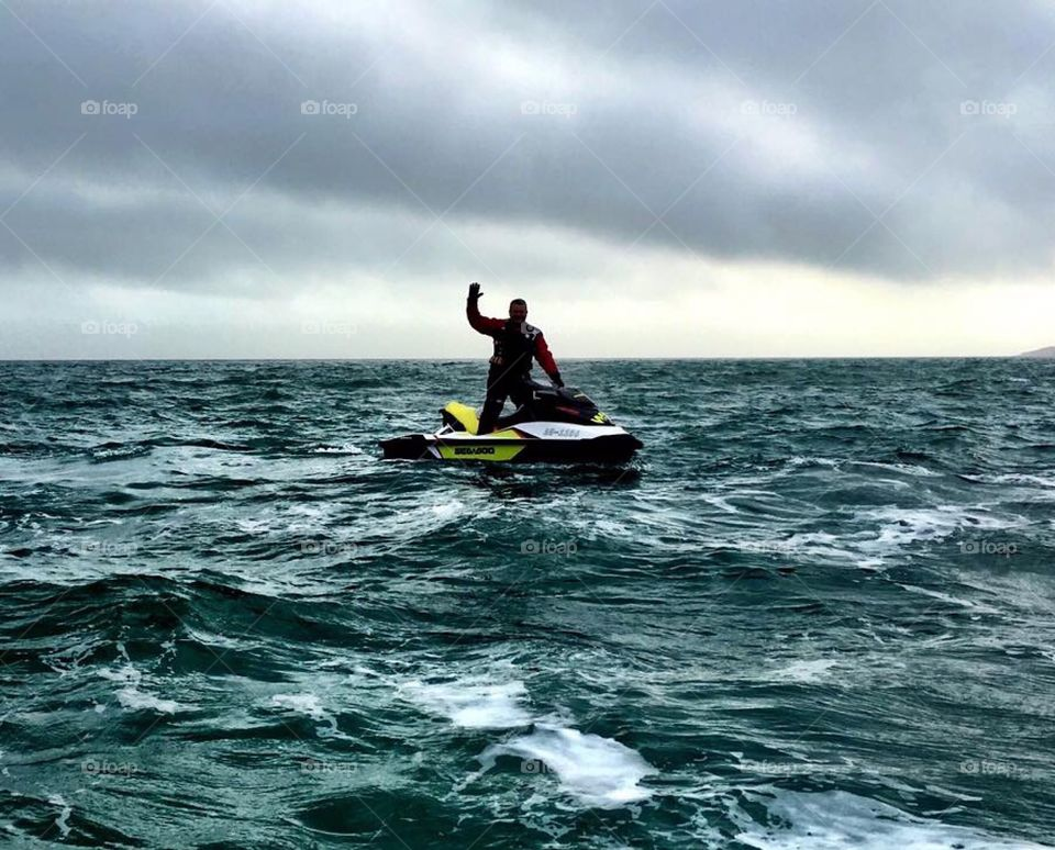 Man Jet skiing in a storm in Weymouth