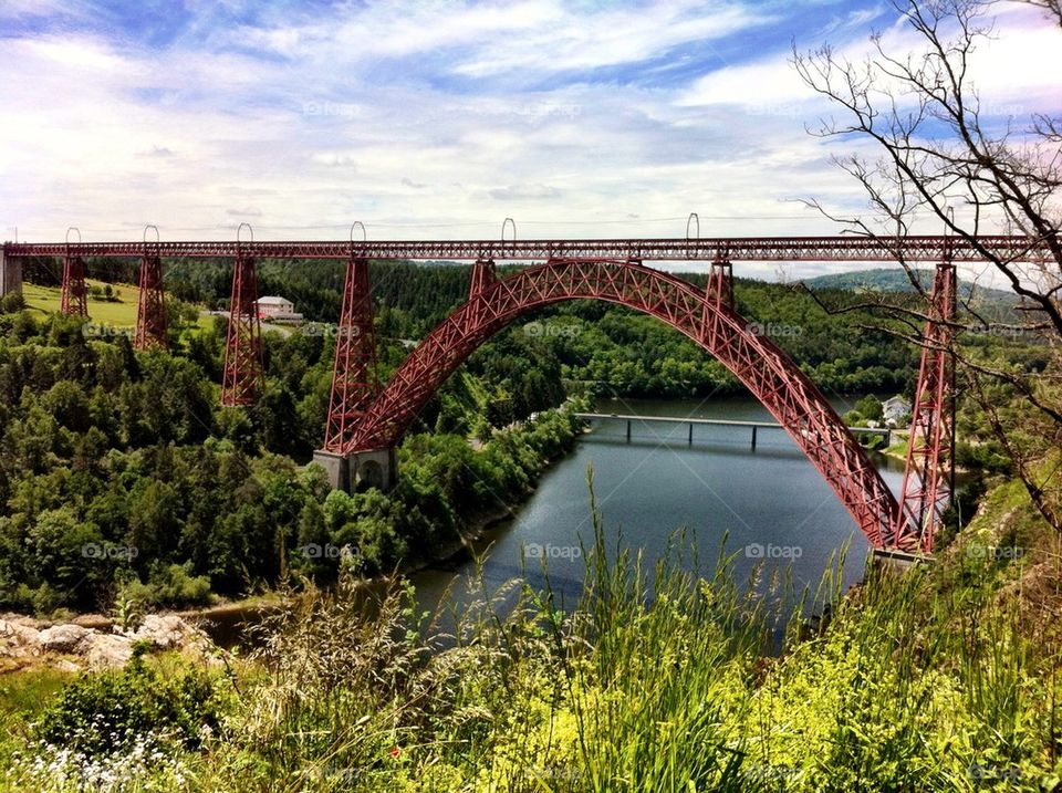 Railway arch bridge named Viaduc de Garabit in France.
