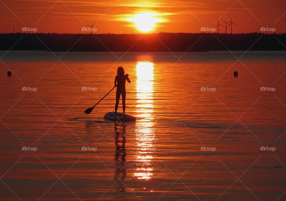 Standup paddling in sunset