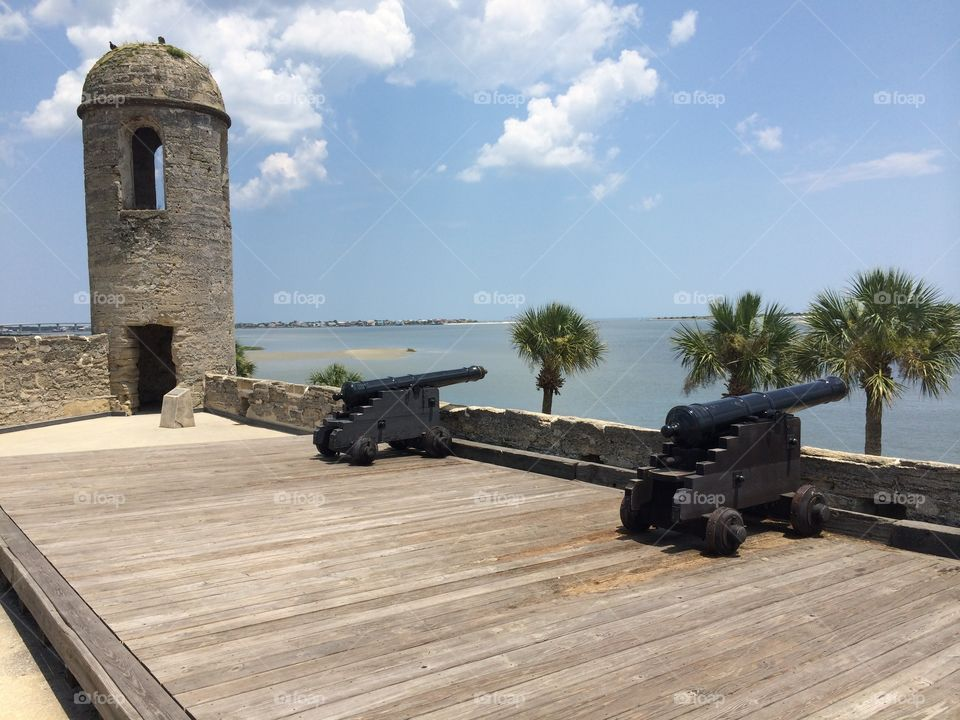 Ancient cannons overlook the shores of Matanzas Bay in Castillo de San Marcos National Monument, St. Augustine, Florida.