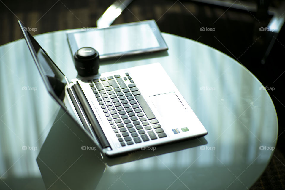 New era New technology New working tools. laptop tablet and lens