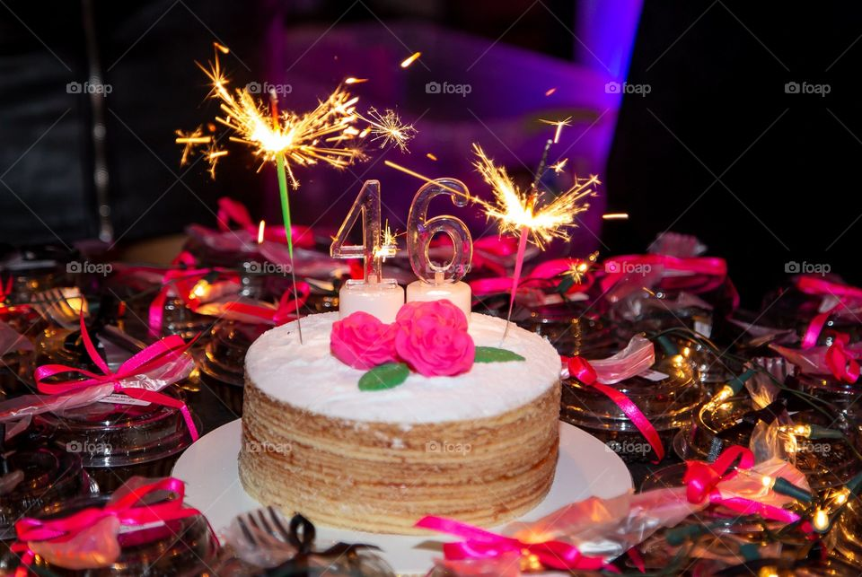 Birthday cake on black and pink background