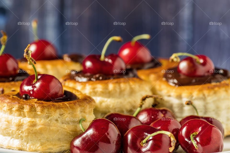 Vol-au-vents filled with dark chocolate and cherry