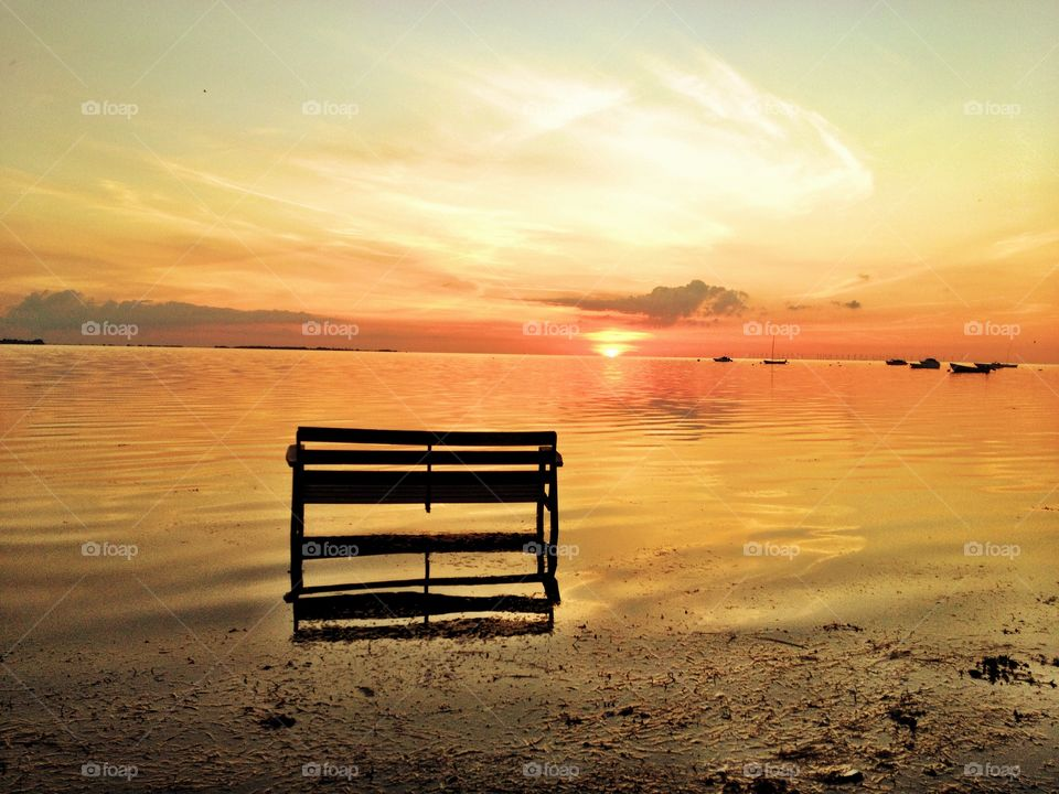 Bench in sunset