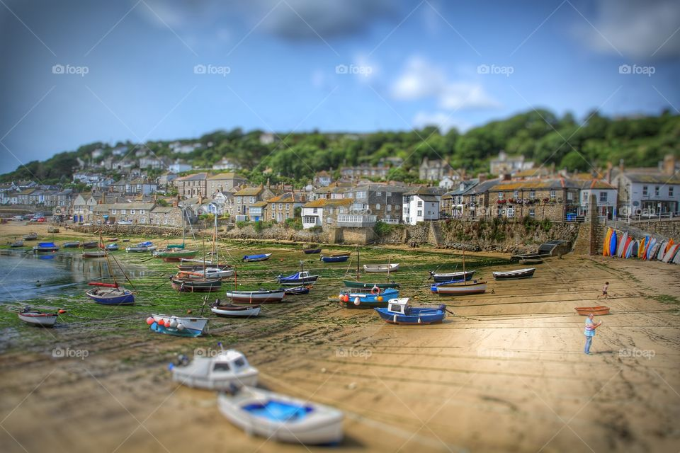 A traditional Cornish fishing village at low tide called Mousehole.
