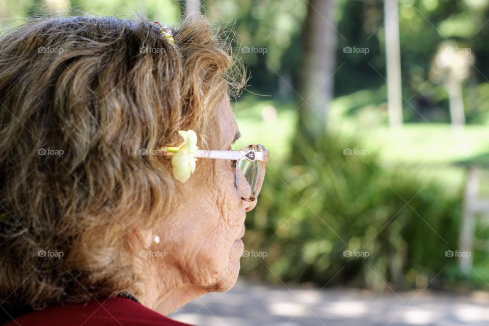 Elderly woman looking at nature in the park
