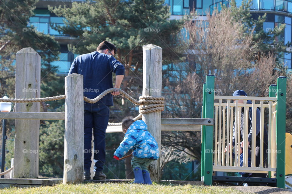 Father and son playing on a playground